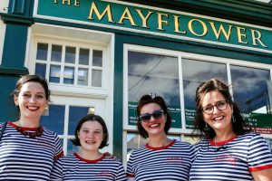 A photo of four Silver Darling singers in front of the Mayflower pub