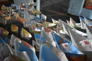 An image of paper boats made by Chinese children, on display at Chelmsford Theatres